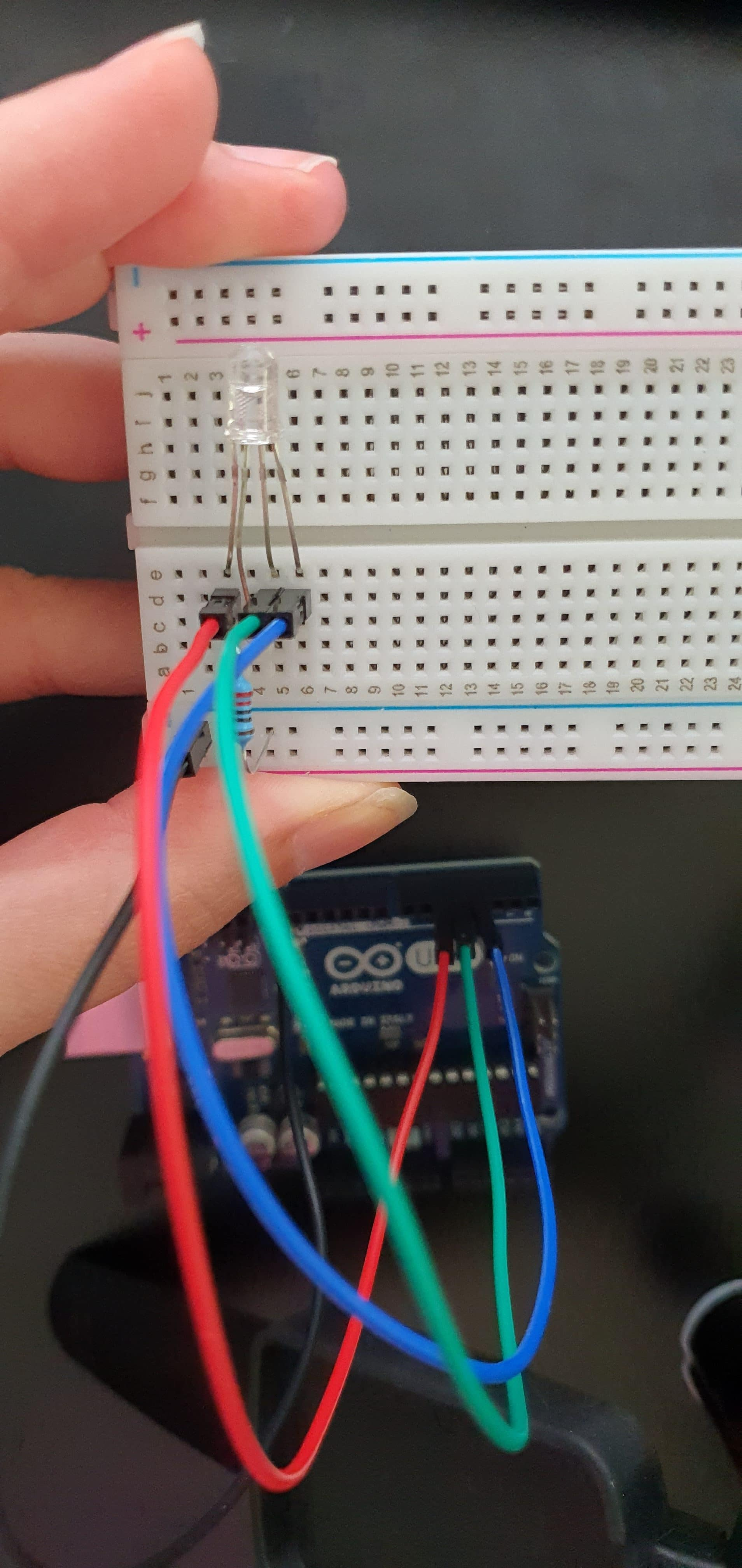 Three wires connected to an Arduino and an electronics breadboard