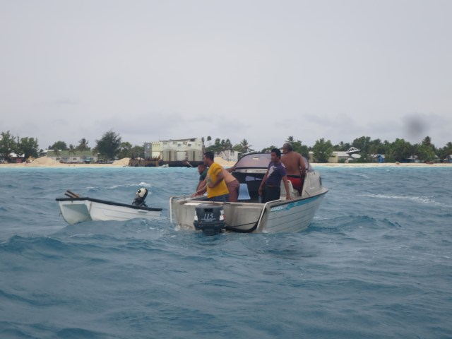dinghy being towed back to our boat. The outboard cactus, the swell big