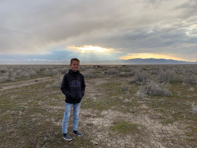 Drew among the sagebrush as the sun starts to break through the clouds.