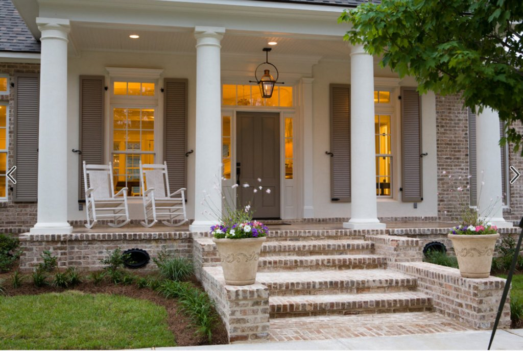 Updating a dated colonial exterior migonis home for 2 story porch columns