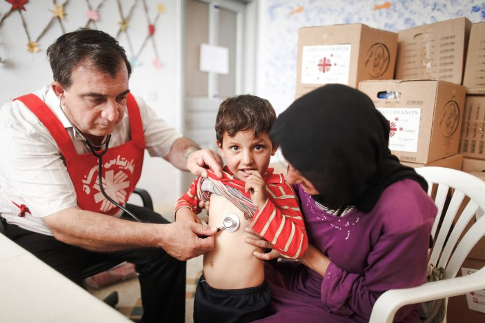 Syrian refugees in Lebanon - patients attend a temporary medical clinic. CRS is supporting Caritas Jordan and Caritas Lebanon as they respond to the tens of thousands of people who've fled Syria since violence erupted in the country in March 2011. Photo courtesy of Sam Tarling for Caritas Switzerland