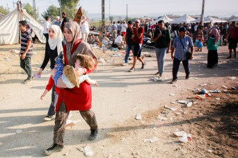 September 5, 2015 in Idomeni, northern Greece, Migrants making their way to cross the Greek-Macedonian border. CRS and it's partner Caritas are helping mostly Syrian migrant refugees with food rations, sleeping bags and mats, hygiene packages, legal advice, counseling and translation services. Photo courtesy of Matthieu Alexandre/Caritas Internationalis