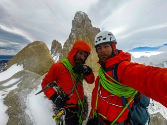 Team is happy on top of Aguja Guillaumet. Fitz Roy in the background.