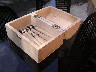 12 pack of wood carving tools in a wooden chest