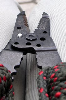 Wire cutter cutting a bolt.