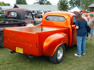 An orange Studebaker custom truck
