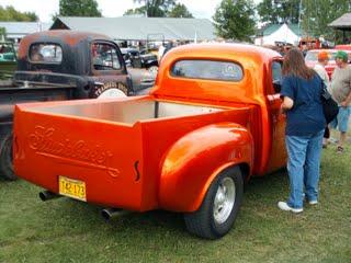 An orange Studebaker custom truck