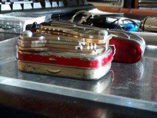 Keys bolted to an Altoids tin as a keychain