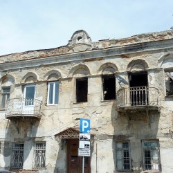 Shabby buildings stand just meters away from the presidential palace, as if to remind the president of his duty