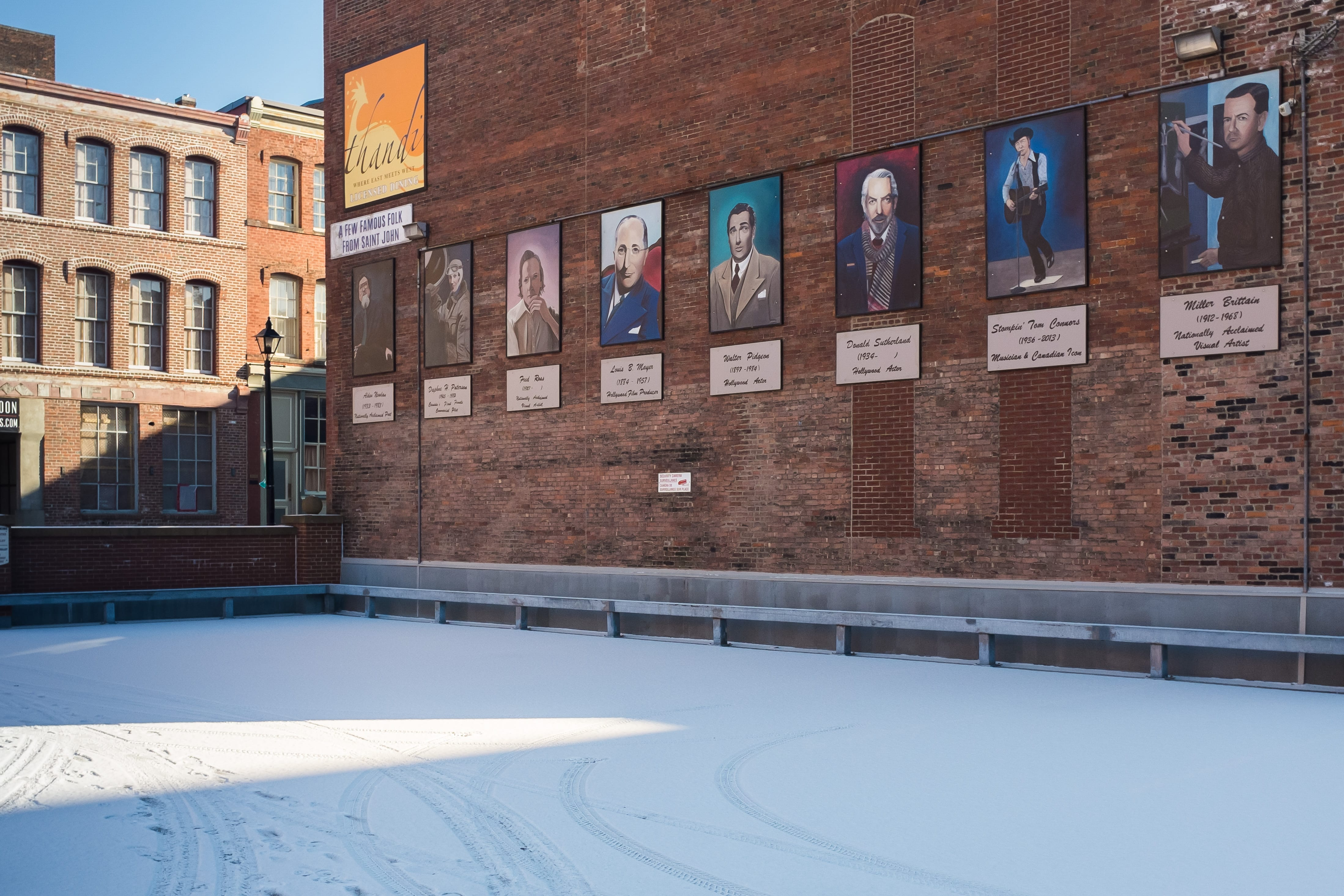 A photograph depicting Famous Saint Johners Mural Winter Parking Lot on Canterbury Street