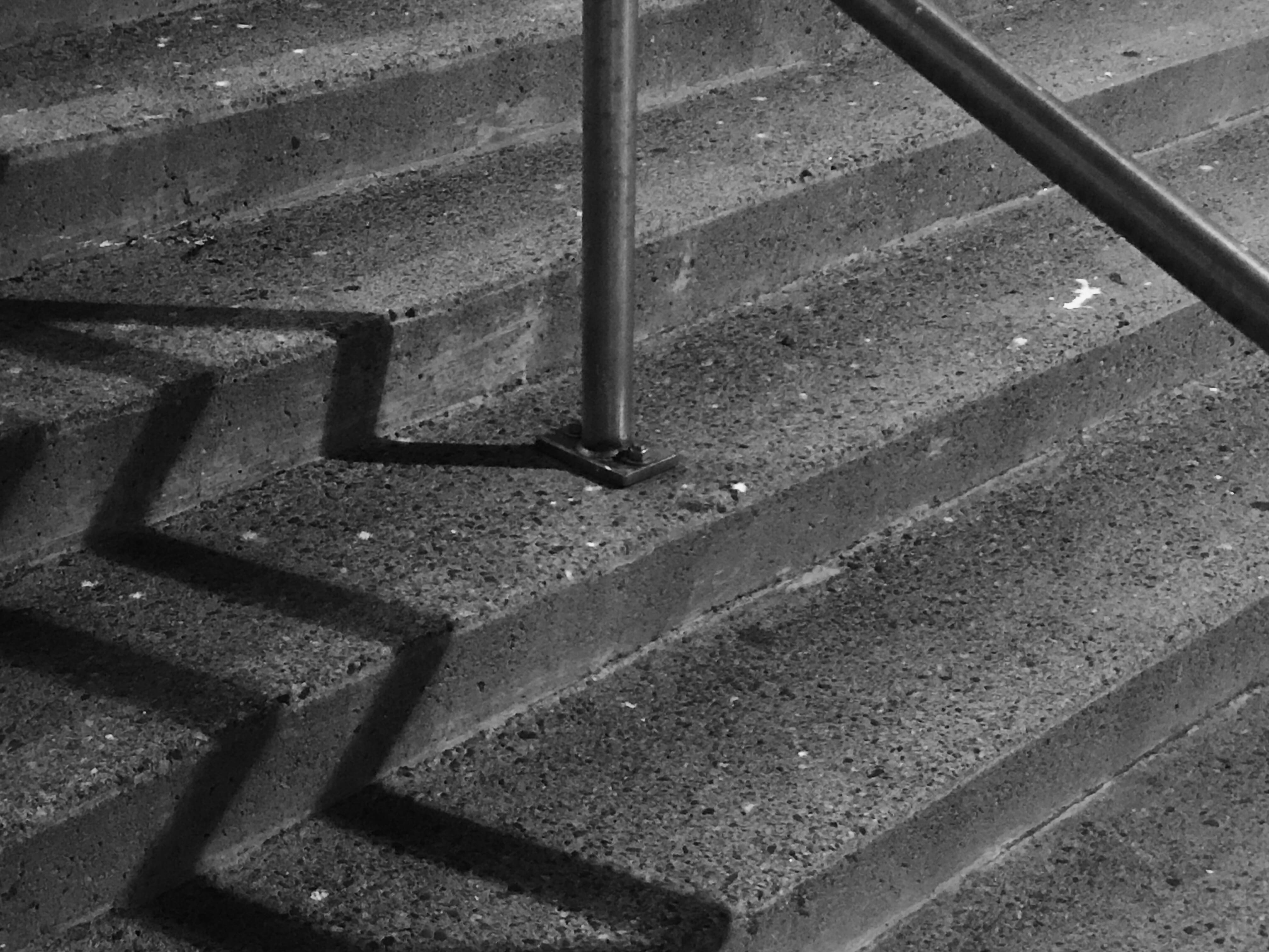 A photograph depicting Market Square Stairs Zig Zag Shadows
