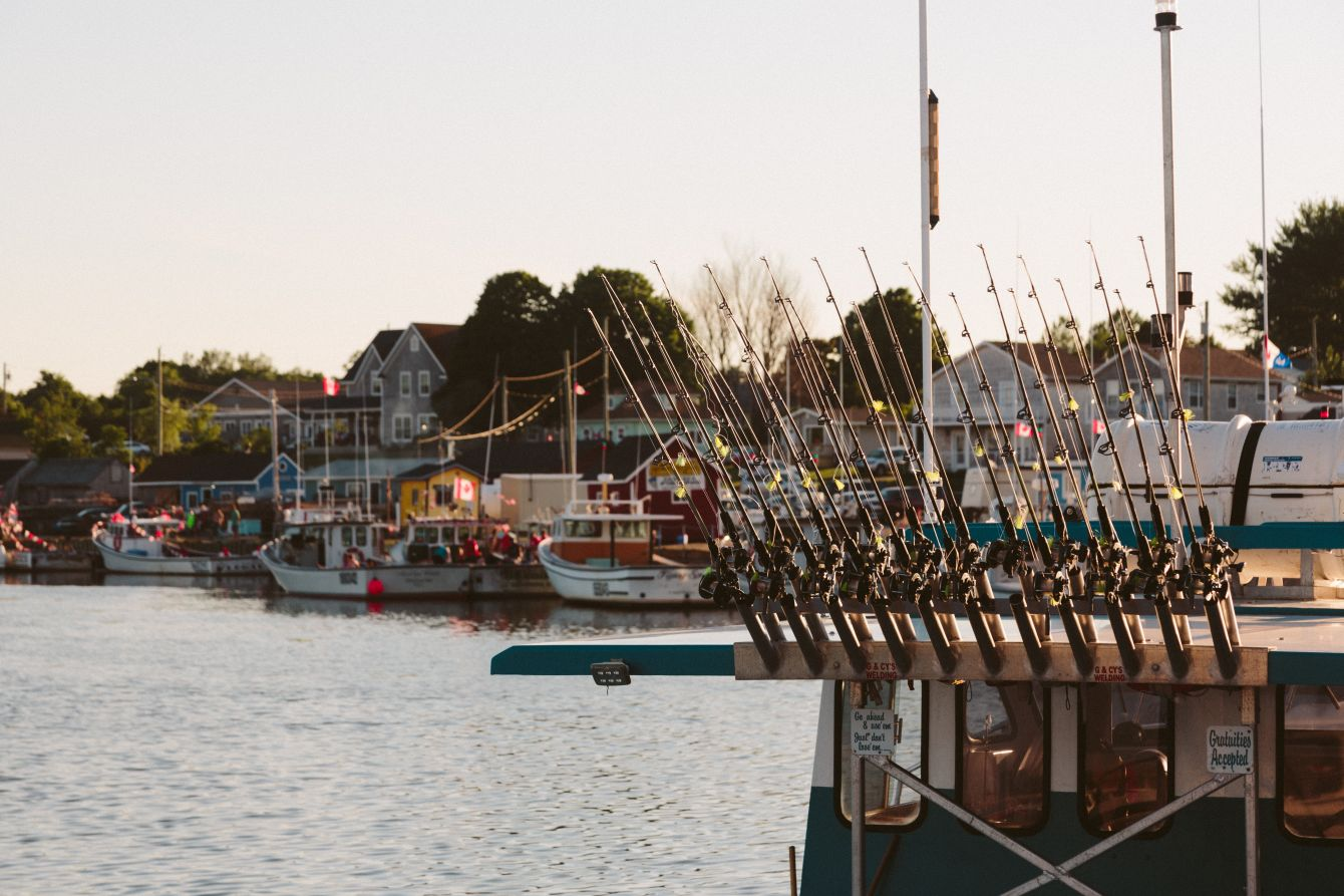 Click thumbnail to see details about photo - Prince Edward Island Stock Photo Fishing Boat Rods Stock Photo