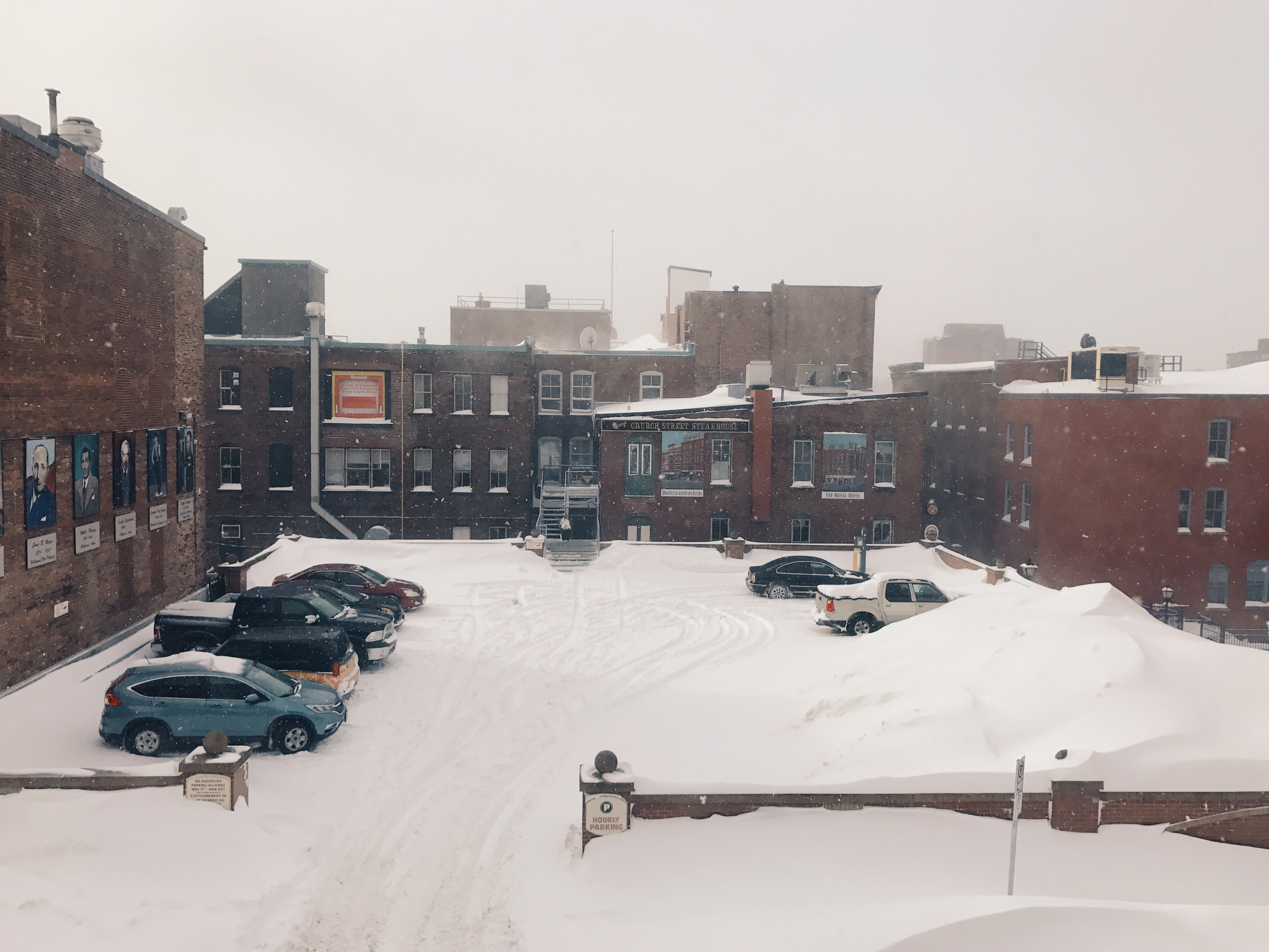 A photograph depicting Snowy Parking Lot on Canterbury Street