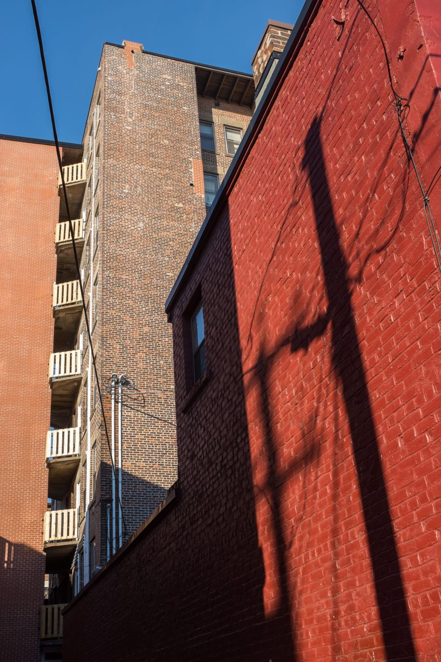 Click thumbnail to see details about photo - Telephone Pole Shadow Against Red Brick Saint John Photograph