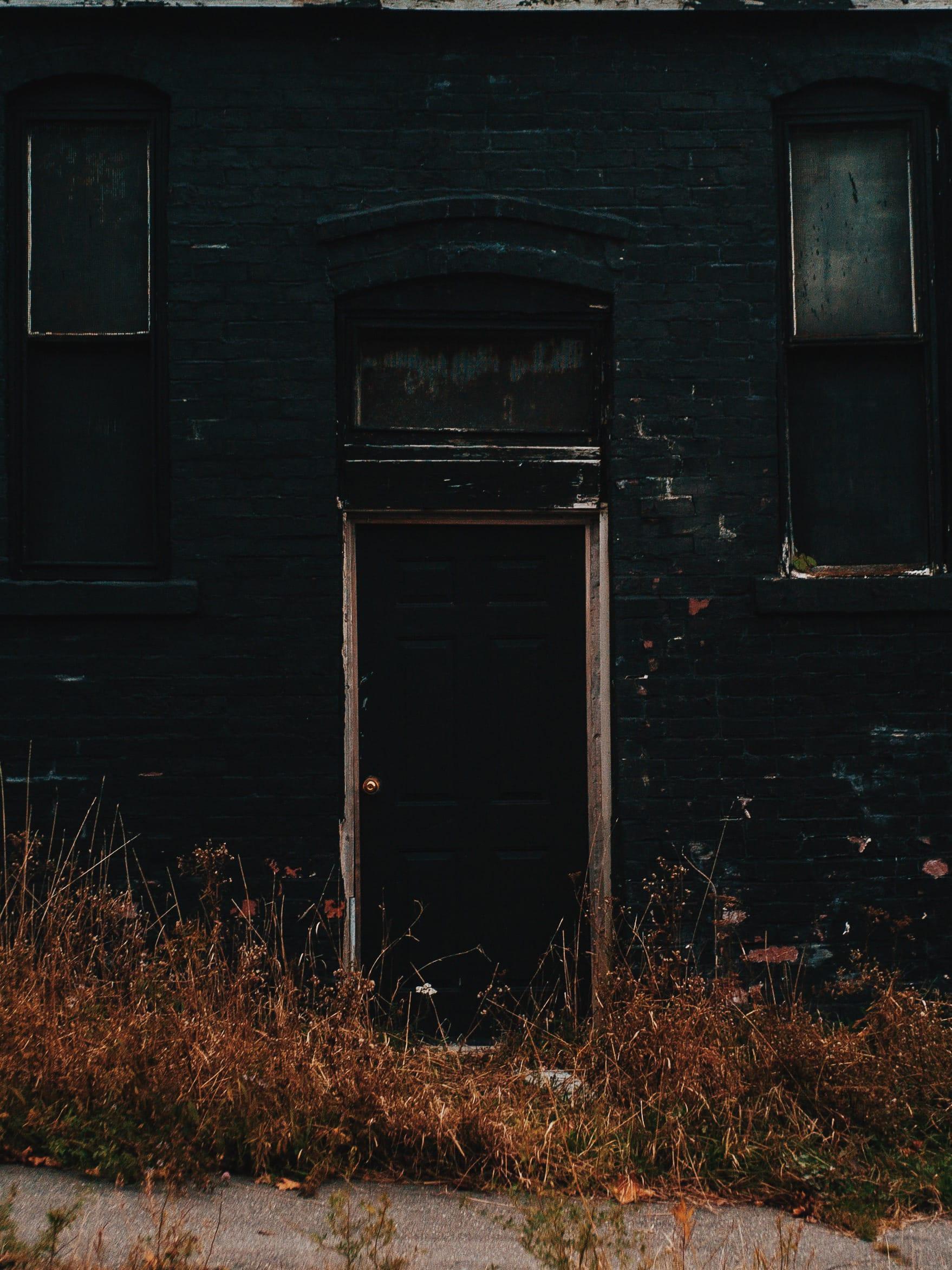 A photograph depicting Black House Door