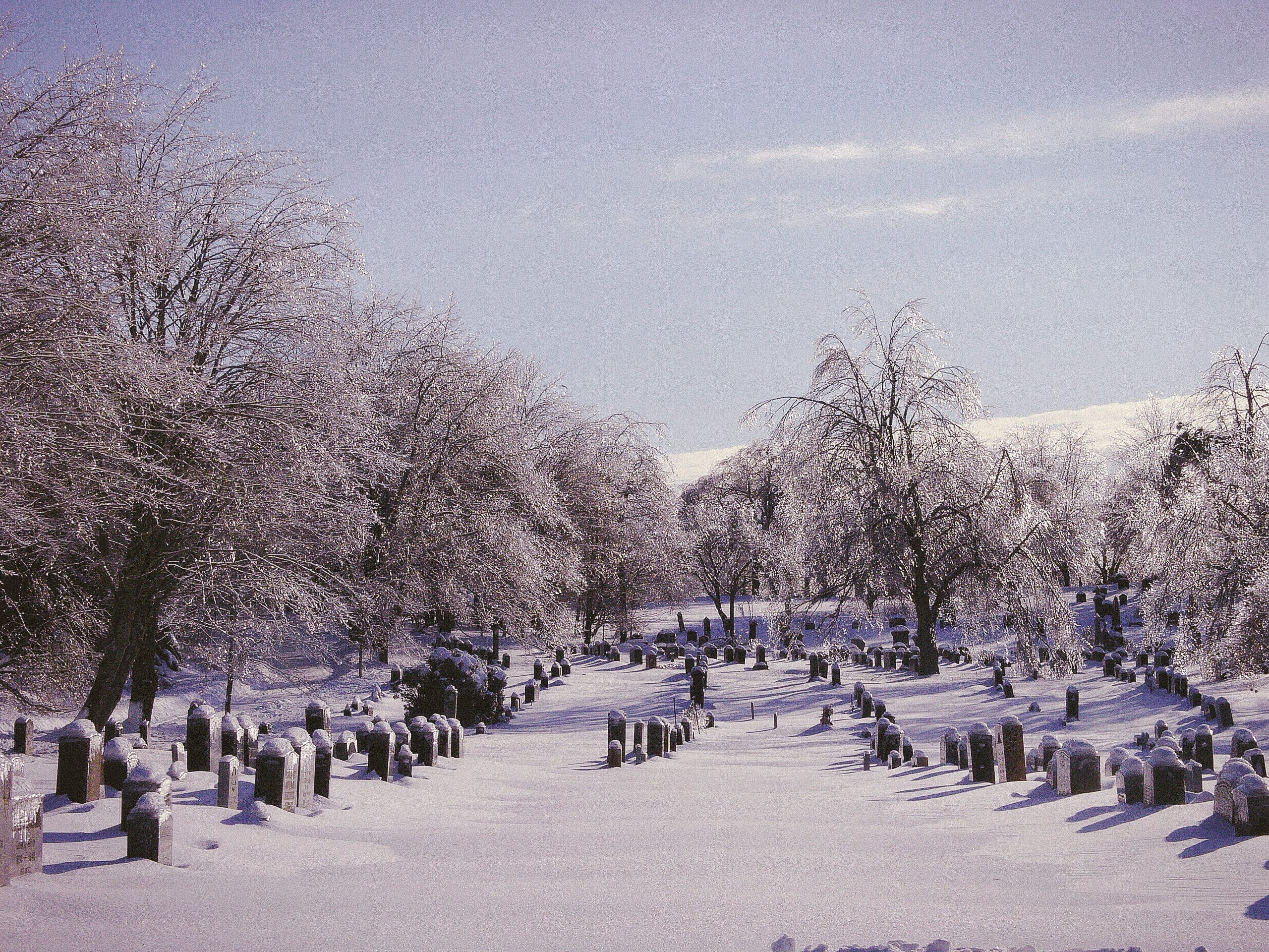 A photograph depicting Saint John Cemetery Covered in Snow