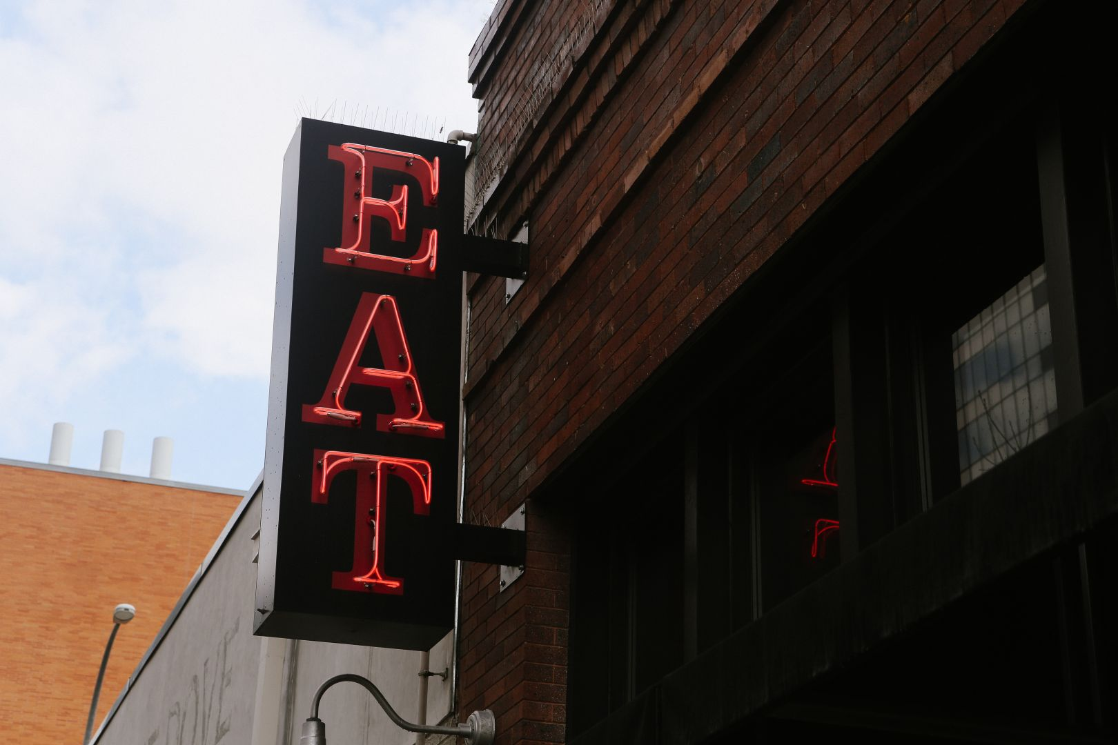 A photo depicting Austin Texas Eat Neon Sign