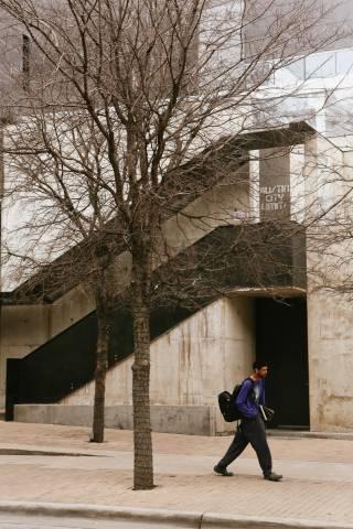 A photo of Man Walking By Austin City Limits