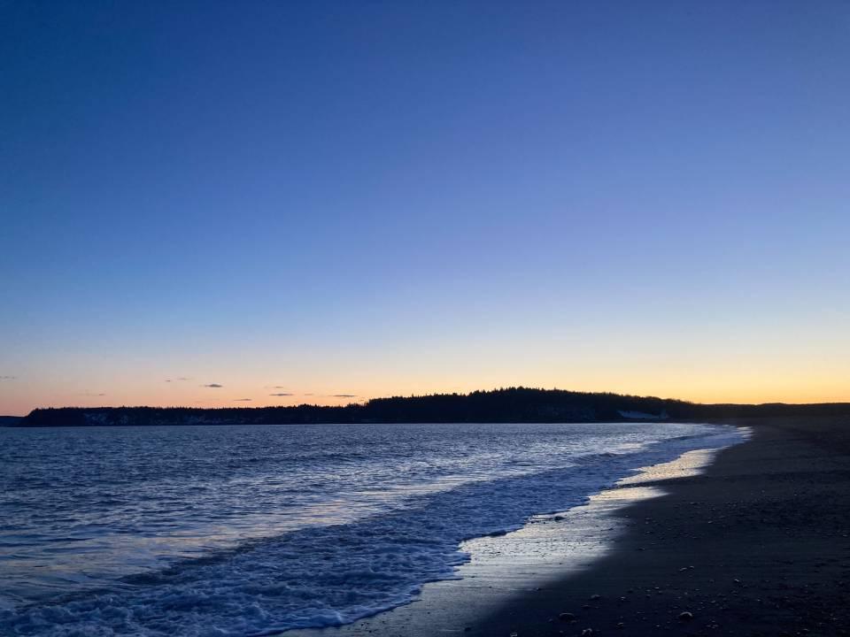 A photo of beach at blue hour