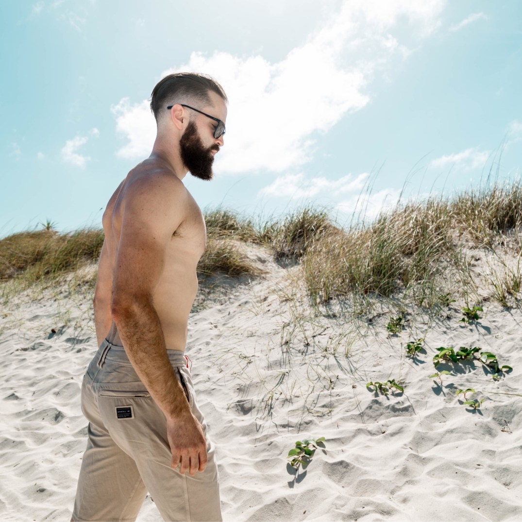 Michael Checkers wearing O'Neil Men's Hybrid Shorts on South Beach, Miami, Florida, USA