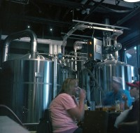 I love the contrast and coloring of the stainless steel tanks in this image. I wish those people weren't there.