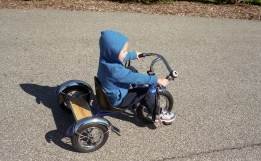 This was an action shot of the child pedaling his bike. The shutter sufficiently stopped motion.