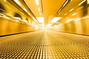 Moving golden escalator