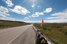 Headed downhill towards Lanerd, WY (Persephone has her flag pole back, now improved with two flags)