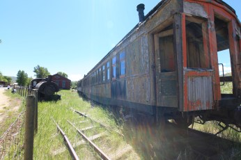 Very old wood rail carriages in Virginia City, MT. Note the smokestacks for burning fires inside the carriage to keep it warm.