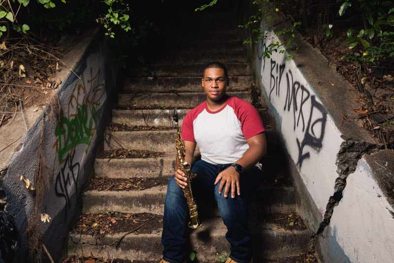 jazz musician sitting on stone steps old fourth ward atlanta