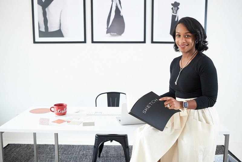 atlanta female entrepreneur reviews notebook at desk of white wall studio woodstock atlanta