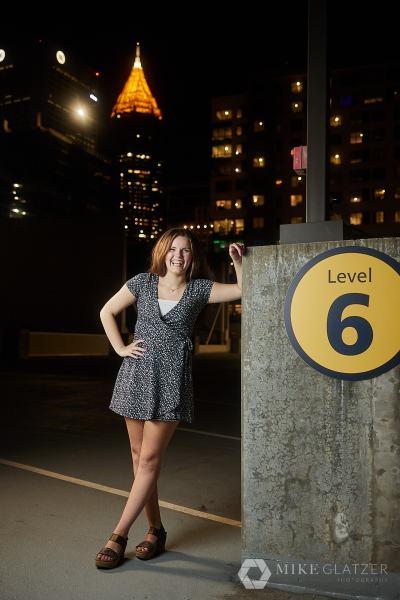 atlanta skyline senior portrait session for high school girl in dress
