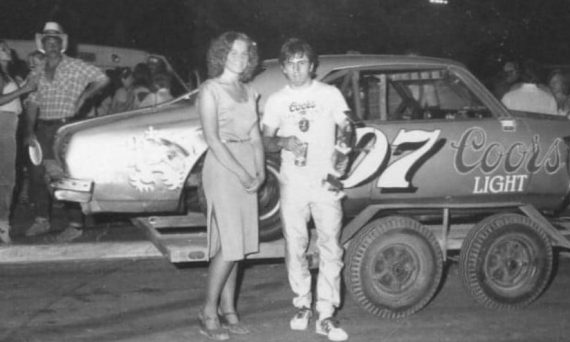 Tom Jones near his Coors Chevrolet race car.