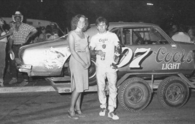 Tom Jones near his Coors Chevrolet race car.