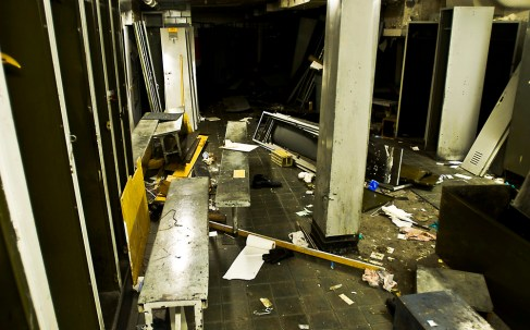 On the first floor of the press room, this destroyed locker room was found. The room appears to have been a gathering place for many people throughout the years with magazines, clothes and other personal items scattered about.