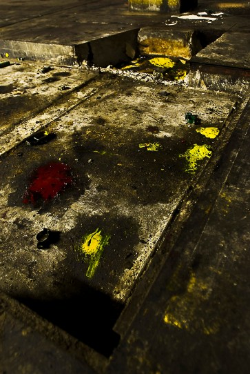 Magenta and Yellow ink stains are left behind in one of the press' left over holes in the foundation.