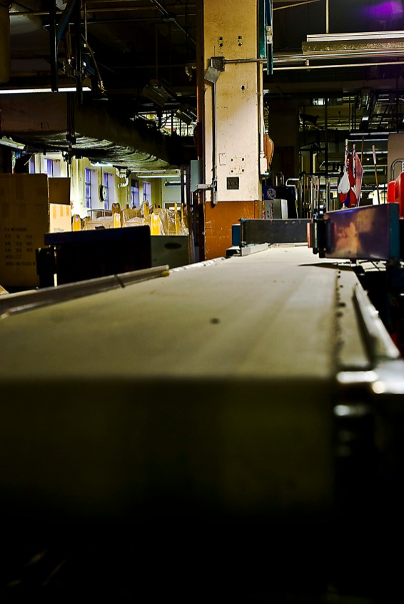 Conveyor belts, which were used to sort direct mail, ads and newspaper bundles, now hide behind mounds of unused equipment, from newsstands to computer screens. The mailroom, a once loud room full of people and machines, is a quiet graveyard.