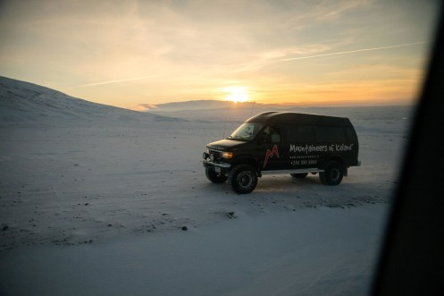 Sunrise at the Golden Circle of Iceland. This super jeep leaves the snow covered road to get ahead of our super jeep. Photo by Mike Higdon