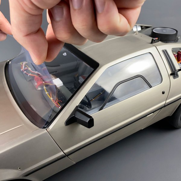 Positioning windshield film on DeLorean model