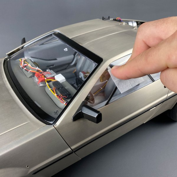 Using screen cleaner wipe on DeLorean driver's side window