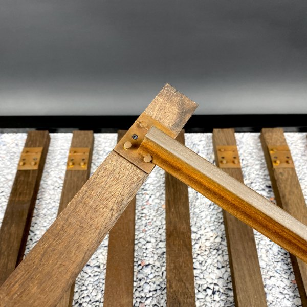 Attaching track to wooden Back to the Future railroad tie