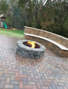 Custom Paver Fire Pit with Paver Bench on a Paver Patio
