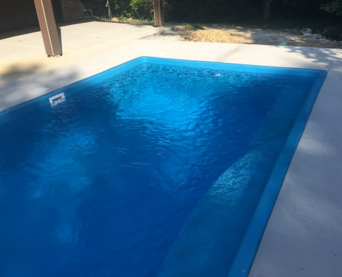 In ground Pool with Concrete Deck
