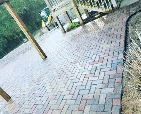 Large Paver Patio Under Deck