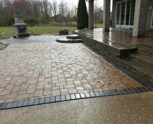 Custom Paver Patio with Retaining Wall Deck and Fire Pit 2