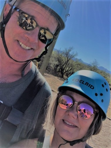 Mike and Lee Pound posing in their zipline helmets after they're both back on the ground.
