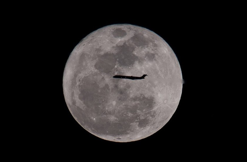 Tamron airplane against moon