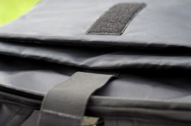 """The back flap of the pack has padded slots for both a 15"""" laptop and a tablet."""
