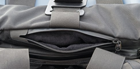 The hidden pocket on top is padded to protect gentler cargo.