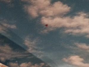 Balloon stuck to fake sky